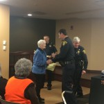 Helen, shaking the undersheriff's hand and accepting her certificate of completion.